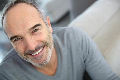 Man smiling after getting veneers